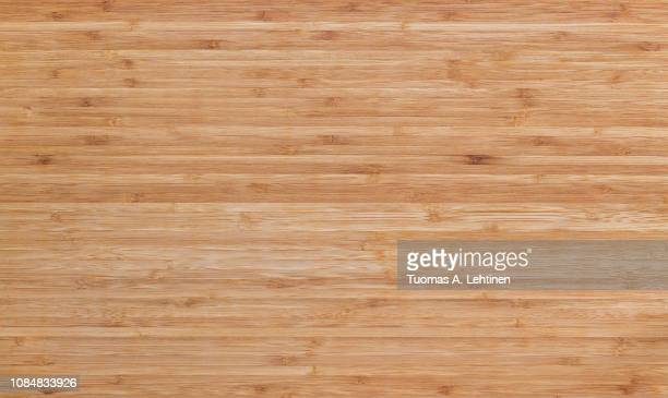 full frame background of natural unpainted bamboo wood board - テーブル ストックフォトと画像