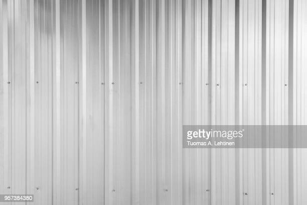 full frame background of shiny corrugated galvanized metal wall texture in black and white - corrugated iron stock photos and pictures
