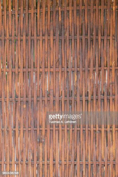 Full frame background of woven wooden wall or fence