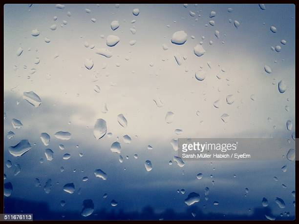 full frame image of glass with rain drops - humid stock pictures, royalty-free photos & images