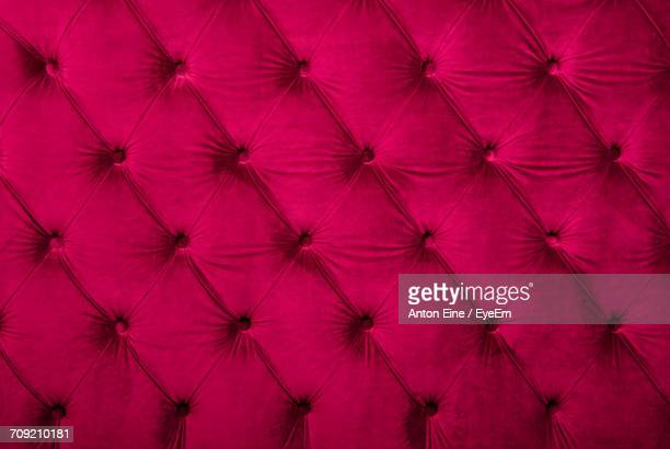 Full Frame Image Of Red Chesterfield Sofa