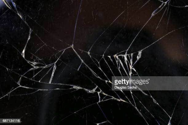 full frame of a broken screen on a mobile device - shattered glass stock pictures, royalty-free photos & images