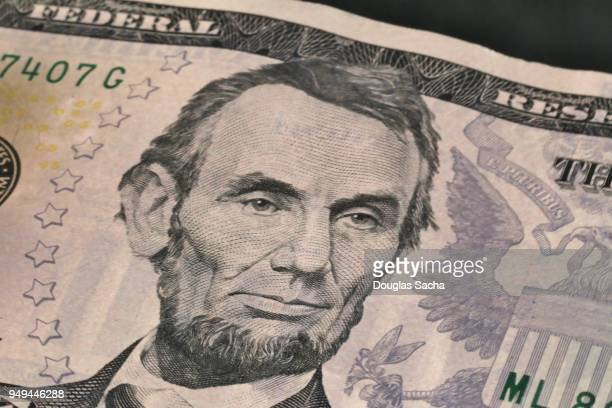 Full frame of a five dollar bill in US currency
