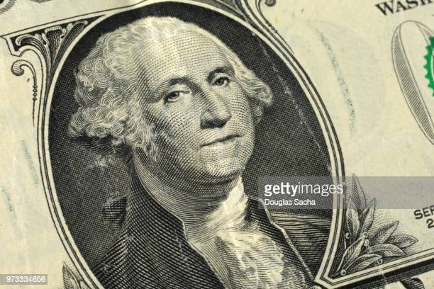 full frame of a one dollar bill in us currency - american one dollar bill stock pictures, royalty-free photos & images