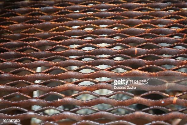 Full frame of a Rusted metal grating walkway