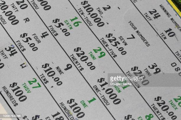 full frame of a scratch off lottery ticket exposing winning numbers - lotterytickets stock pictures, royalty-free photos & images