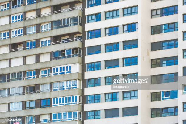full frame of apartment block - demography stock pictures, royalty-free photos & images