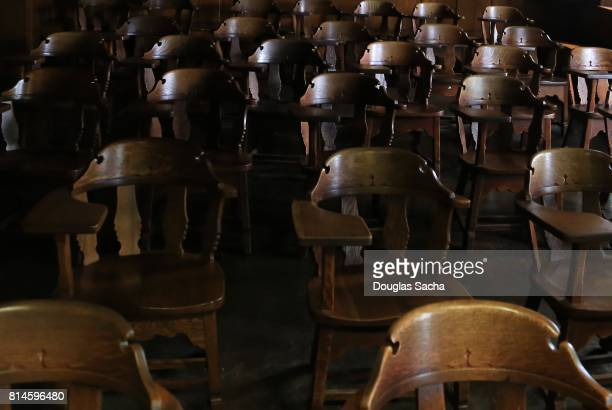 Full frame of empty seating in a educational assembly hall