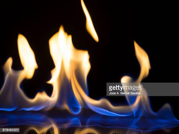 Full frame of flames and natural fire, on a black background.