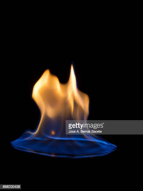 Full frame of flames and natural fire, on a black background