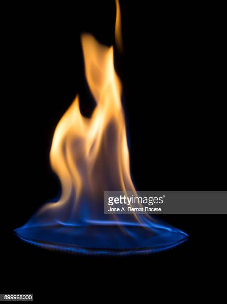 full frame of flames and natural fire, on a black background. - flame stock pictures, royalty-free photos & images