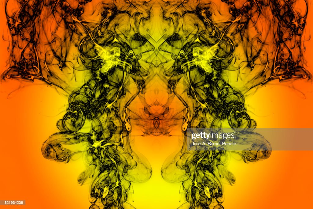 Full frame of forms and figures of smoke of color black and gray in ascending movement  on a orange background : Stock Photo