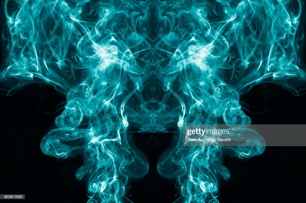 Full frame of forms and figures of smoke of color blue and white in ascending movement   on a black background : Stock Photo