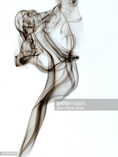 Full frame of forms and figures of smoke of color gray in ascending movement produced, by an explosion on a white background