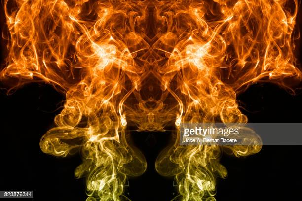 full frame of forms and figures of smoke of color orange and yellow in ascending movement , on a black background - translucent stock pictures, royalty-free photos & images