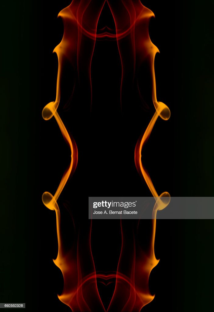 Full frame of forms and figures of smoke of color orange in ascending movement  on a black background : Stock Photo