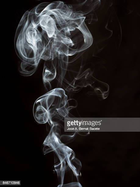 full frame of forms and figures of smoke of color  white in ascending movement , on a black background - smoke physical structure stock pictures, royalty-free photos & images