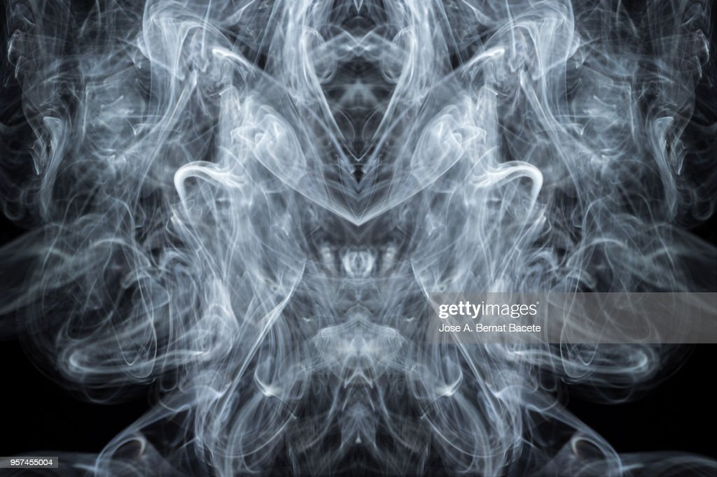 Full frame of forms and figures of smoke of color white in ascending movement  on a black background : Stock Photo