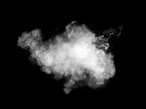 Full frame of forms and textures of an explosion of powder and smoke of color white and gray on a black background. - gettyimageskorea