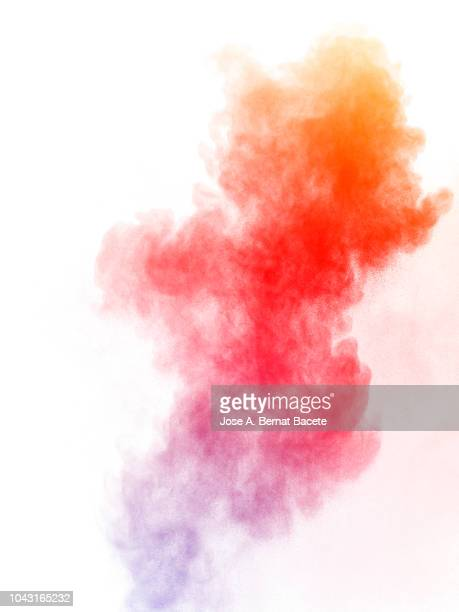 full frame of forms and textures of an explosion of powder and smoke of color red and orange on a white background. - colour image stock pictures, royalty-free photos & images