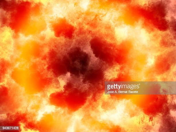 full frame of forms and textures of an explosion of powder and smoke of color yellow and red on a orange background. - hell stock pictures, royalty-free photos & images