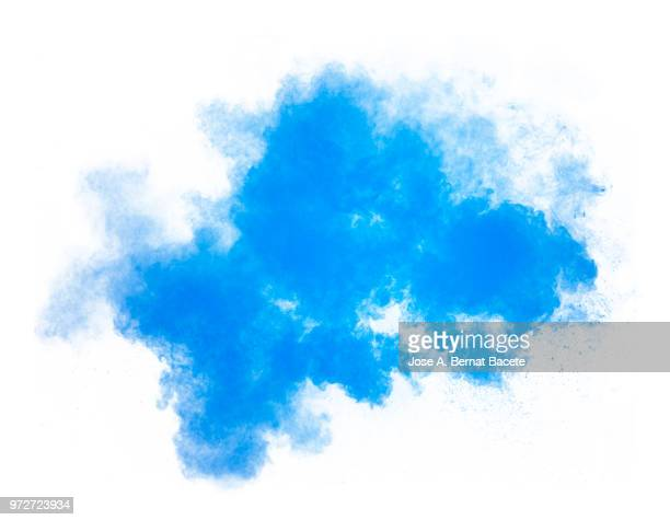 full frame of forms and textures of an explosion of powder and smoke of color light blue and dark blue on a white background. - dust stock pictures, royalty-free photos & images