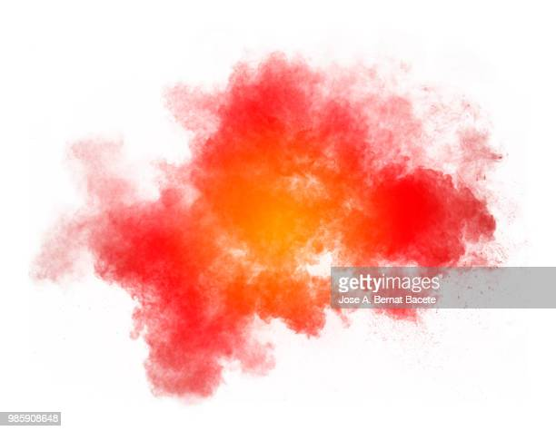 Full frame of forms and textures of an explosion of powder and smoke of color yellow and red on a white background.
