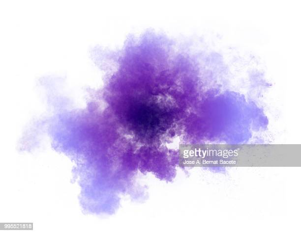 Full frame of forms and textures of an explosion of powder and smoke of color red and violet and purple on a white background.