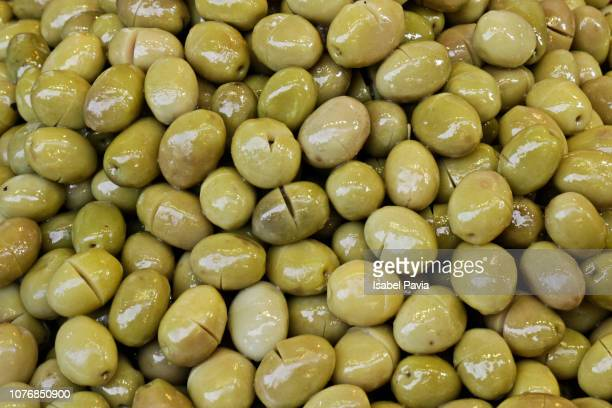 full frame of fresh olives - green olive stock photos and pictures