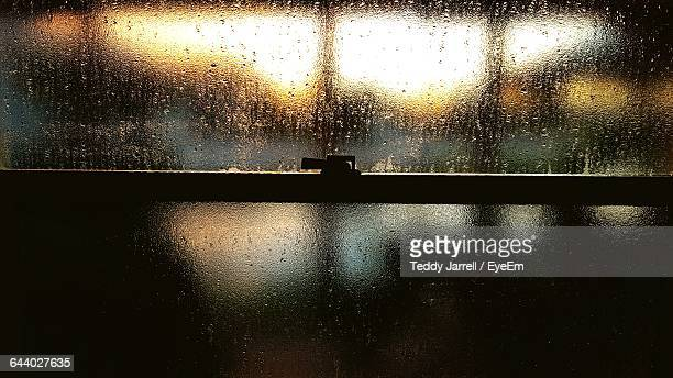 Full Frame Of Glass Covered With Raindrops