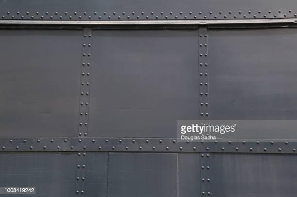 full frame of metal panels riveted together - 鉄 ストックフォトと画像