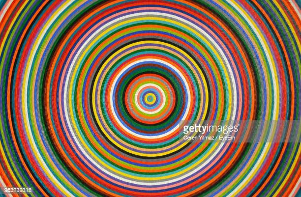 full frame of multi colored concentric pattern - concentric stock pictures, royalty-free photos & images