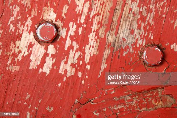 full frame of peeling red paint and nails - janessa stock pictures, royalty-free photos & images