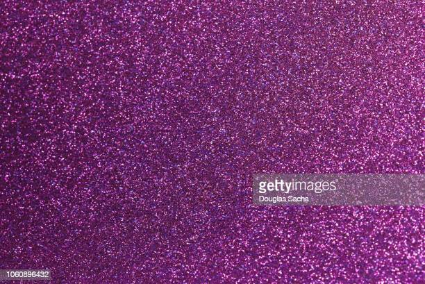 full frame of purple glitter - glittering stock photos and pictures