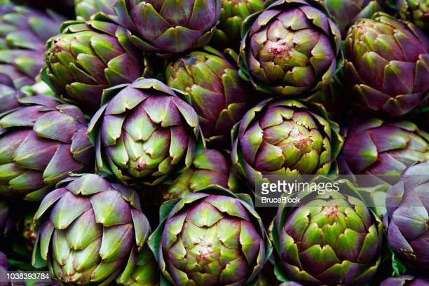 full frame of purple italian artichokes - close up stock pictures, royalty-free photos & images