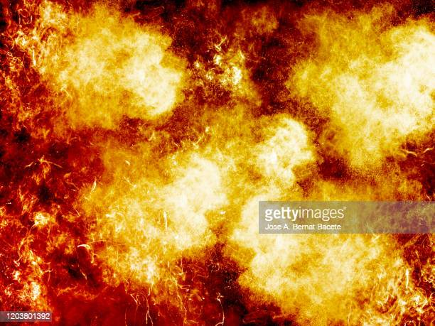 full frame of smoke and fire on a black background. - explosive stock pictures, royalty-free photos & images