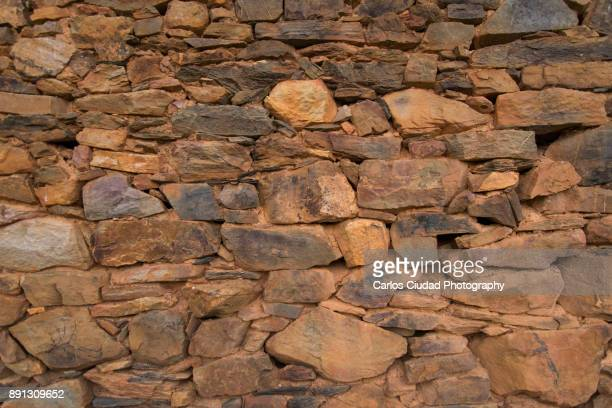 full frame of stone wall from a traditional house of la cabrera, leon, spain - stone wall imagens e fotografias de stock