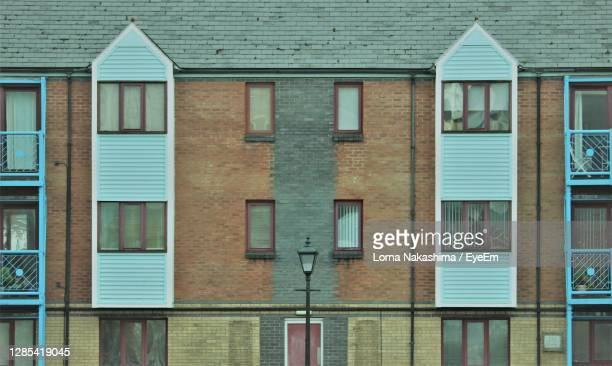 full frame of symmetrical brick building facade - flat stock pictures, royalty-free photos & images