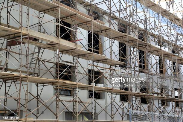 full frame of temporary worker scaffolding during the construction of a building - foundation make up stock pictures, royalty-free photos & images