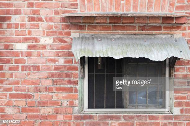 Full Frame of Texture, Brick Wall with an Old Window