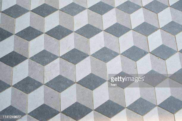 full frame of texture, floor tiles in a gray 3d-effect isometric cube pattern - isometric projection stock photos and pictures
