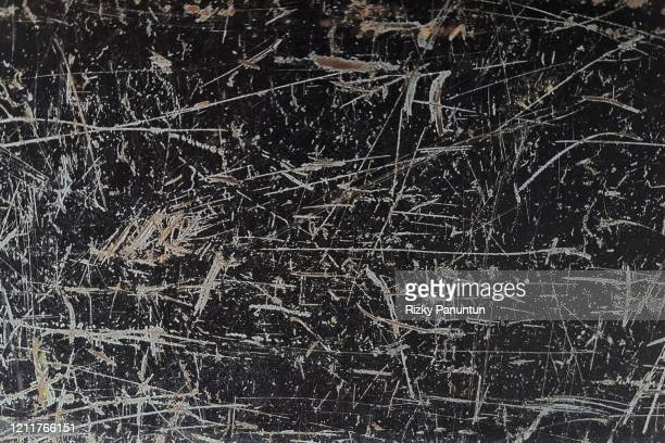 full frame of texture of the old black metal plate - scratched stock pictures, royalty-free photos & images