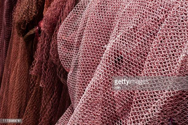 full frame of texture, red fishing net - 網状 ストックフォトと画像
