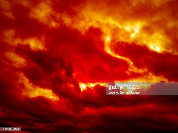 full frame of the background of sky with red and orange clouds. - apocalypse stock pictures, royalty-free photos & images