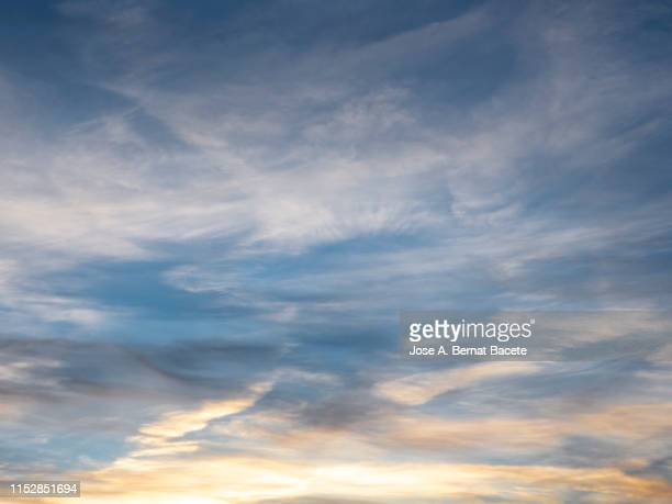 full frame of the low angle view of clouds in sky during sunset. - nublado fotografías e imágenes de stock
