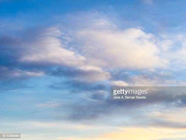 full frame of the low angle view of clouds in sky during sunset. valencian community, spain - nuvoloso foto e immagini stock