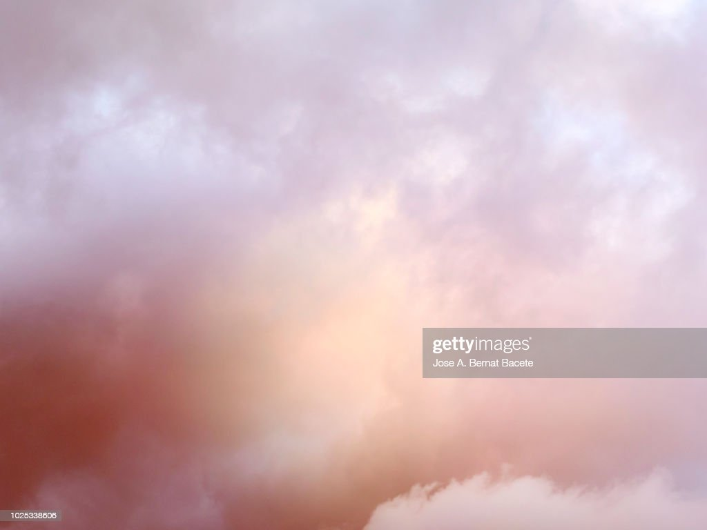 Full frame of the low angle view of clouds of colors in sky during sunset with crepuscular light. Valencian Community, Spain : Stock Photo