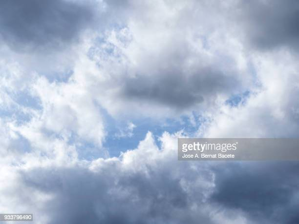 Full frame of the low angle view of sky blue and clouds  of white and gray color. High resolution photography