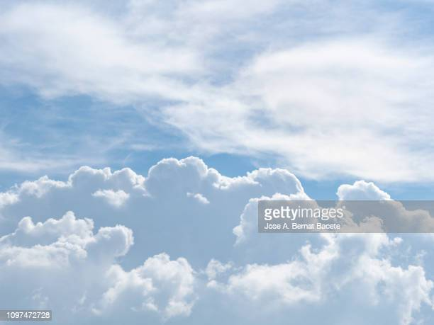 full frame of the low angle view of white color clouds  with a blue sky. - heaven stock pictures, royalty-free photos & images