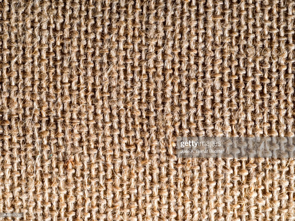 Full frame of the textures and colors of a fabric of burlap of brown color : ストックフォト